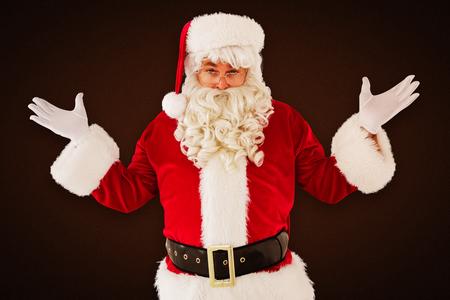 perplexed: Portrait of perplexed santa against white background with vignette Stock Photo