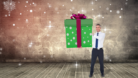 grimy: Stylish man with giant gift against grimy room