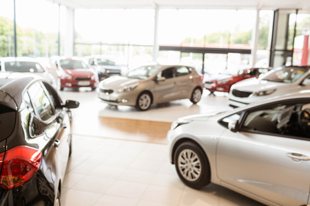 retail: View of row new car at new car showroom