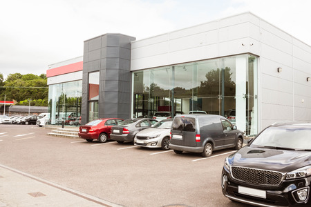 Outside view of car dealership at new car showroom