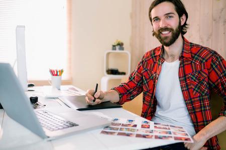 designer: Handsome designer working at his desk in casual office Stock Photo