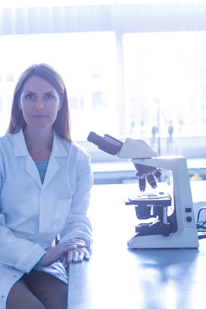 biochemist: Scientist working with a microscope in laboratoryat the university