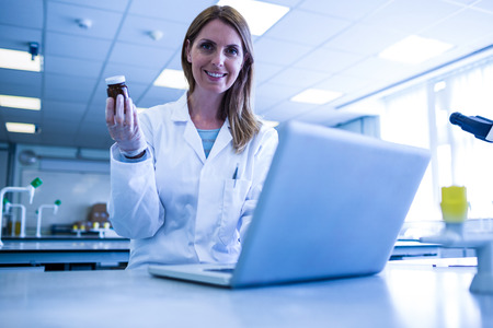 research science: Scientist working with a laptop in laboratory at the university