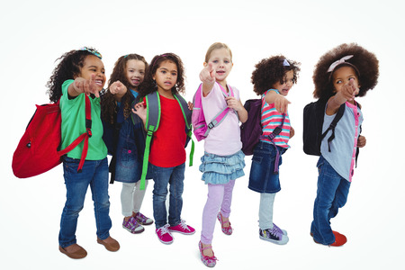 schoolkids: Line of schoolkids with bags against a white background Stock Photo