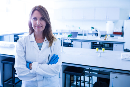 Scientist smiling at the camera in lab in the university