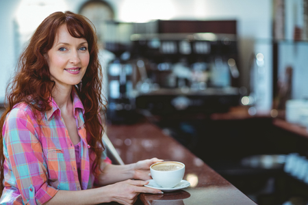 mature student: Mature student smiling in cafe at the university Stock Photo