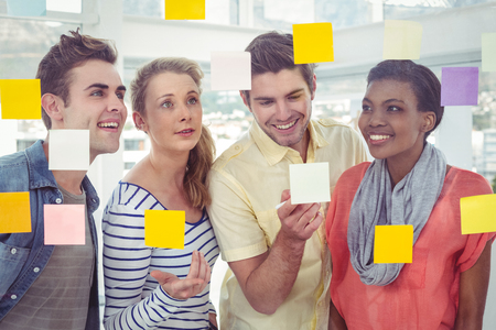 post it notes: Creative team using post it notes in casual office Stock Photo