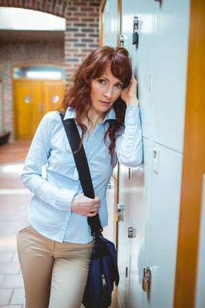 mature student: Mature student feeling stressed in hallway at the university Stock Photo