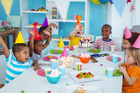 birthday decoration: Excited kids enjoying a birthday party together