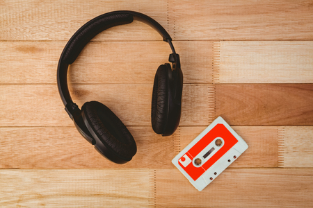 old desk: Close up view of old tape and headphone on wood desk