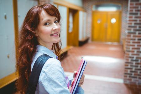 mature student: Mature student opening her locker at the university