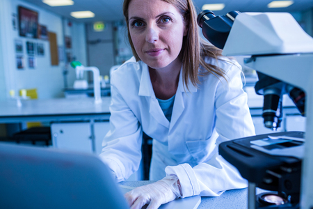 biochemist: Scientist working with a laptop in laboratory at the university