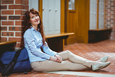 mature student: Mature student smiling at camera in hallway at the university
