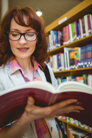 thirties: Mature student in the library at the university