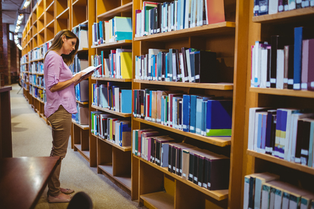 college campus: Mature student in the library at the university