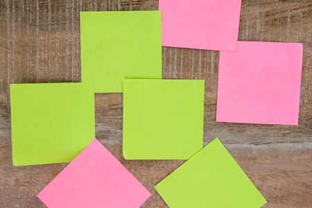 post it notes: Post it notes on wooden table