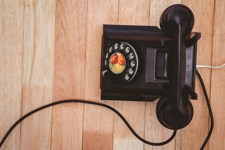 turn dial: View of an old phone on wood desk