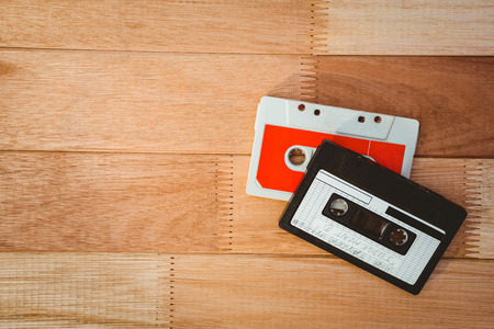 old desk: Close up view of old tapes on wood desk