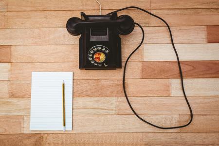 bakelite: View of an old phone on wood desk