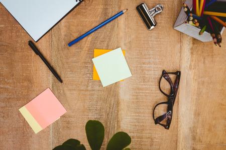 pen holder: Close up view of business stuff on wood desk