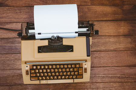 old desk: View of an old typewriter on wood desk