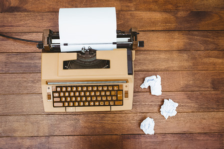 old desk: View of an old typewriter and paper on wood desk Stock Photo