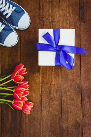 close up view: Close up view of sneakers and blue gift