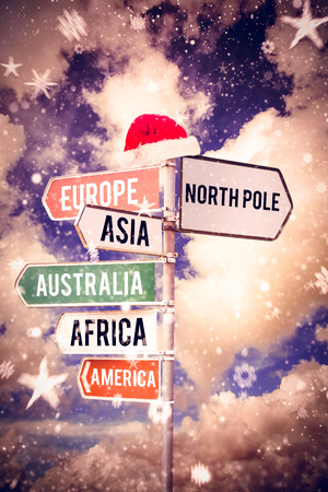 north pole sign: Continents against multi colored sign posts against cloudy sky Stock Photo
