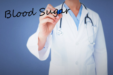 blood sugar: The word blood sugar and doctor pointing felt pen  against blue background