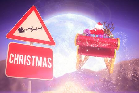 christmas village: Christmas road sign against christmas village under full moon