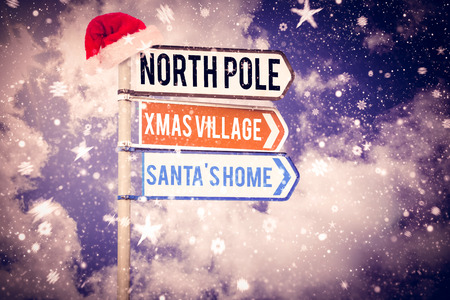 northpole: Santas address against blank sign posts against cloudy sky Digital image of blank sign posts against cloudy sky Stock Photo