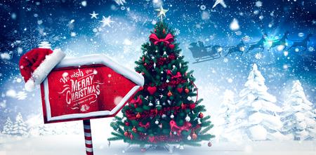 雪に覆われた森でクリスマス ツリーにクリスマスの挨拶 写真素材
