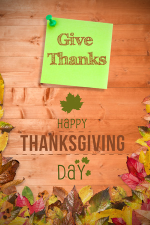 give thanks to: Happy thanksgiving against illustrative image of pushpin on green paper