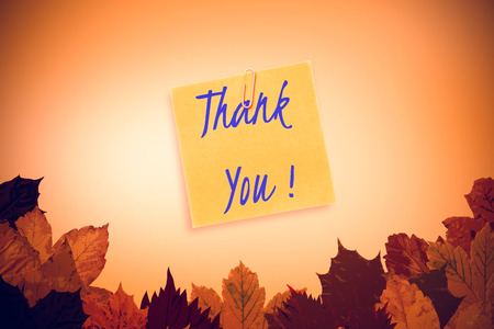 happy thanksgiving: happy thanksgiving against autumn leaves with yellow note Stock Photo