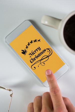 using smartphone: Businessman using smartphone against christmas greeting