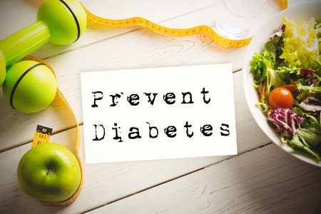 prevent: Prevent diabetes against healthy food with measure tape Stock Photo