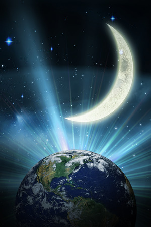 crescent: earth against crescent moon in the night sky Stock Photo