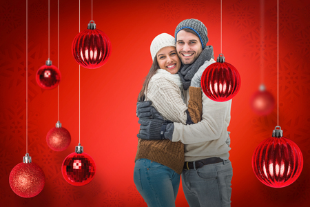 couple winter: Young winter couple against red snowflake background