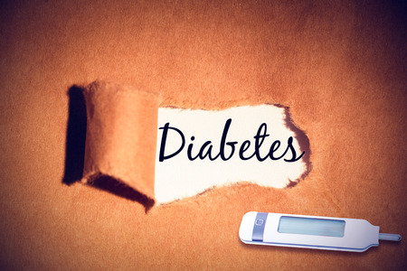 tearing down: diabetes against directly above shot of torn paper