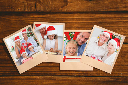 swapping: Smiling old couple swapping christmas gifts against instant photos on wooden floor