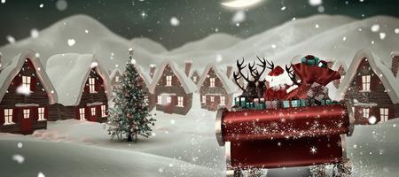 christmas village: Santa flying his sleigh against cute christmas village at night