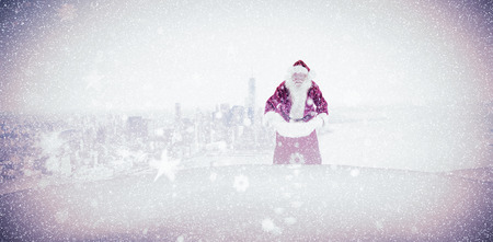falling tide: Santa open his red bag against city by the sea Stock Photo