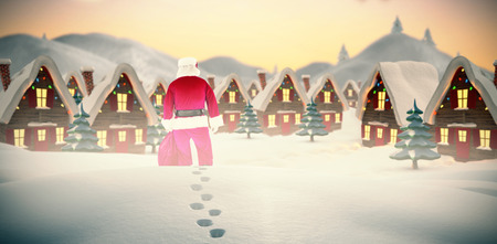 adult footprint: Rear view of santa claus holding a sack against cute christmas village with trees Stock Photo