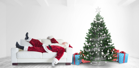 taking nap: Santa Claus taking a nap against home with christmas tree Stock Photo