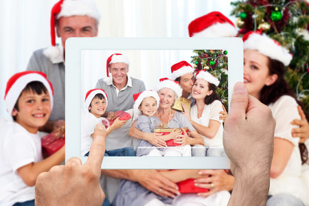 Composite image of hand holding tablet pc photo