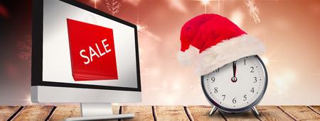western script: Christmas clock against snowflake design shimmering on red