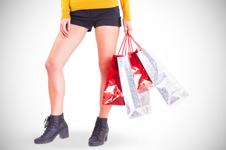 hot pants: Stylish woman with shopping bags on white background