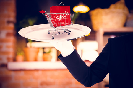 white gloves: Hand with white gloves holding a silver tray against empty counter at coffee shop Stock Photo