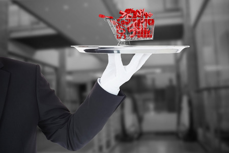 silver tray: Hand with gloves holding a silver tray against online shopping concept Stock Photo
