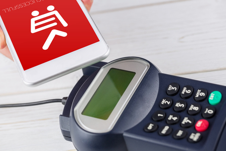 eftpos: Payment successful on screen against man using smartphone to express pay